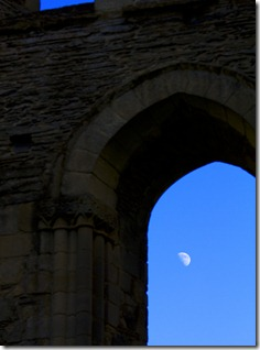 Moon through arch